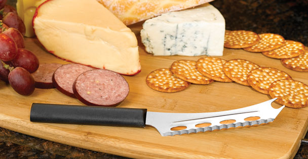 The Rada Cutlery cheese knife cuts and serves all types of cheeses with its forked end designed for serving.