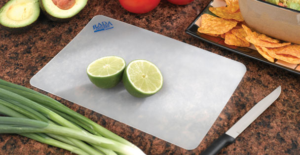 These small plastic cutting boards are the perfect size for cutting fruits like limes.
