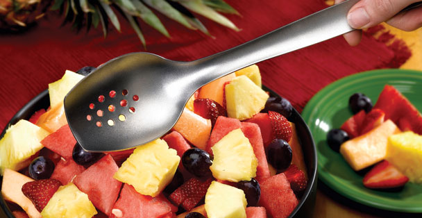 The silver cook's spoon with holes by Rada Cutlery has a long handle which makes stirring and serving foods simple.