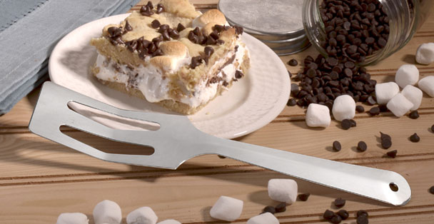 The serverspoon laying by a piece of s'mores pie.