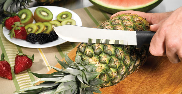 The large butcher knife is perfect for cutting up a pineapple.