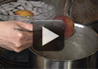 A video on how to blanch peaches to remove the skin.