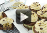 A video on how to make cookie dough stuffed cupcakes.