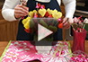 Step by step directions on how to create your own homemade pineapple and strawberry edible fruit bouquet.