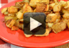 A video demonstration on how to make fried potatoes in a skillet.