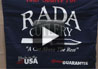 "<div><h1>Table Runner</h1></div><div>The table runner is a quick way to make a table display stand out from the crowd. The Table Runner is placed across the table and attractively shows the Rada Cutlery logo as well as the Made in the USA and Lifetime Guarantee logos down the front.</div><div>The table runner could also be hung behind the table if desired - more like a banner to provide more visibility to your selling table or booth.</div><div>The Table Runner is 28"" wide and 72"" long and is made from a 65/35 blend of poly/cotton twill. The table runner will make your selling table look attractive and professional and create a positive first impression.</div>"