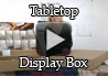 "<div><h1>Tabletop Display Box Intro</h1></div><div>This unit can both store and display your Rada Cutlery individual knives and utensils (all sizes and shapes). </div><div>The Tabletop Display Box is 35 ½"" x 21 ½"" overall. It has 5 sections that are shorter for holding items such as the paring knives, steak knives, etc. as well as 5 sections that are medium length for displaying and storing items such as the slicers and ice cream scoop. There are also 2 sections that are longer for displaying items such as the bread knives or Cooks Spoons. </div><div>The display box can be adjusted to several different heights depending on the height of your table and your preference.  Included is a brightly colored banner to attract attention to your event table. </div><div>When your event is over, your display becomes your storage box.  Simply remove the price cards and banner, take down your display and the base is used as the lid.</div><div>The Tabletop Display Box can be used alone if you are only selling the individual kitchen knives and utensils at your event table. Or it can be used in combination when selling Rada Cutlery gift sets and other products (stoneware, cookbooks, soy wax candles and quick mixes).</div>"