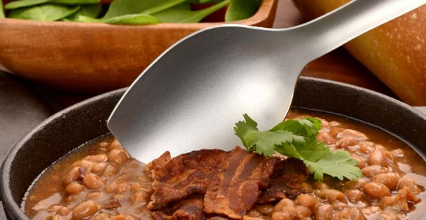 A magnified shot of the Plain Cookspoon serving baked beans with bacon.
