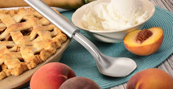 Ice Cream Scoop with peaches and peach pie.