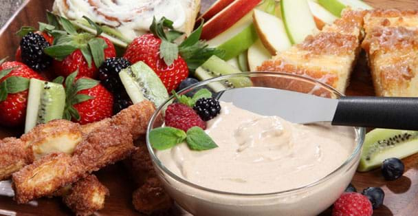 Cinnamon Sweet dip on a plate with party spreader in dip.