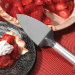 A beautiful strawberry pie alongside a Rada Serrated Pie Server.