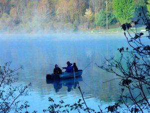 Three fisherman enjoy the great outdoors.