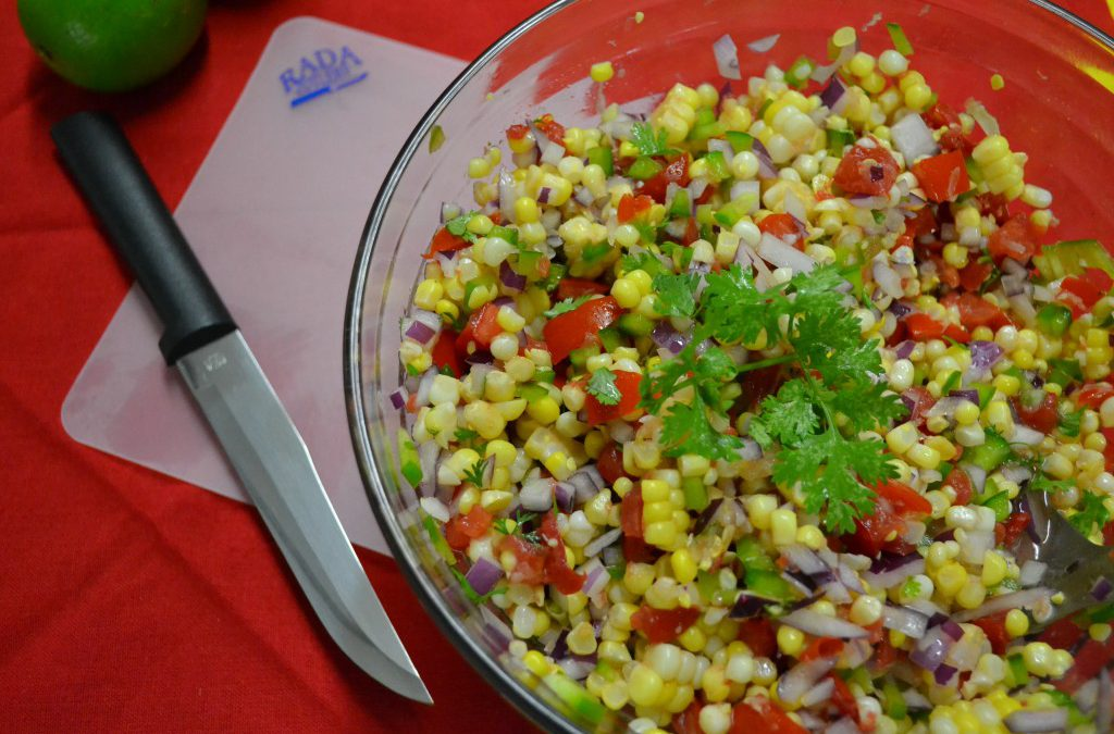 A bowl of corn salad with the Rada Cutlery Slicer.