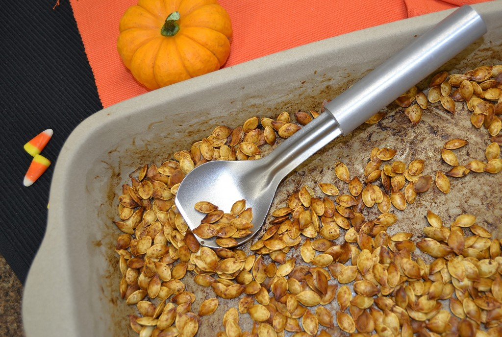 A batch of roasted pumpkin seeds with the Rada Cutlery Ice Cream Scoop.