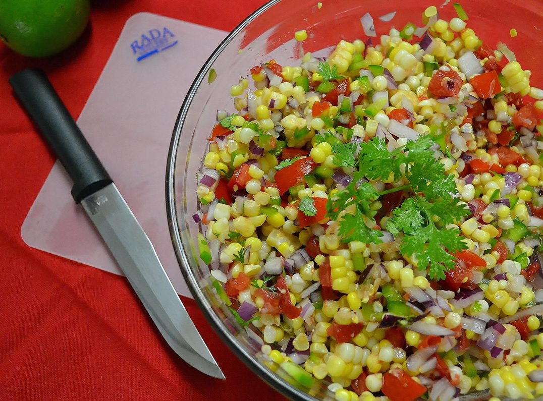 A delicious corn salad alongside a Rada Slicer.