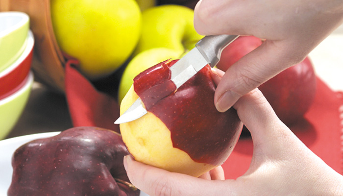 Regular paring Knife cutting apple