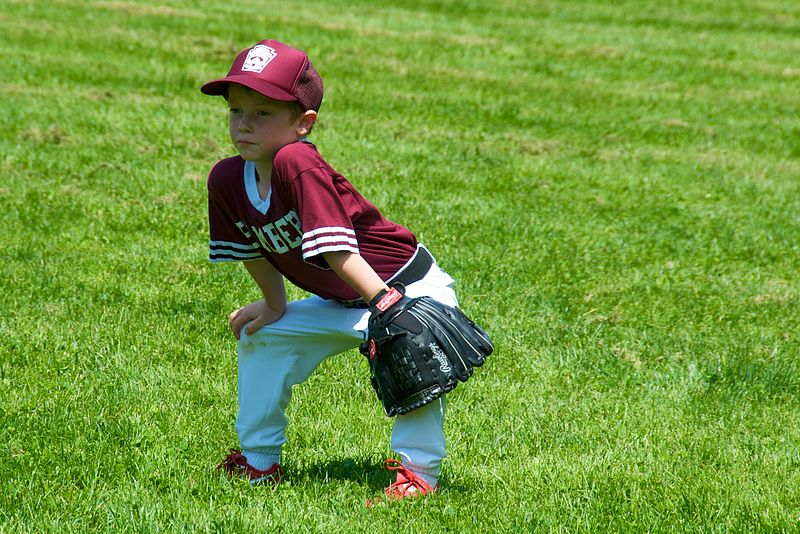A child enjoys a game of baseball.