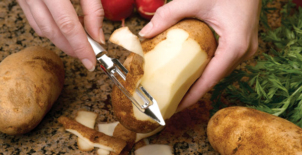 Vegetable Peeler peeling a potato