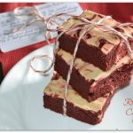 A stack of red velvet cheesecake bars made with Rada Cutlery products.