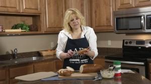 Spread garlic parmesan spread over bread slices