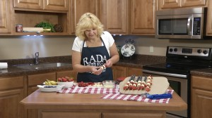 Skewering fruit in Flag Fruit kabob video