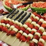 A platter of fruit kabobs made with Rada Cutlery products.