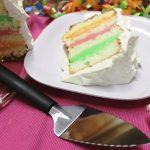 A beautiful slice of rainbow cake with the Rada Serrated Pie Server.