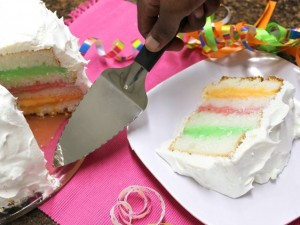 Serving Rainbow Ice Cream Cake