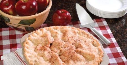 An apple pie beside a Rada Serrated Pie Server.