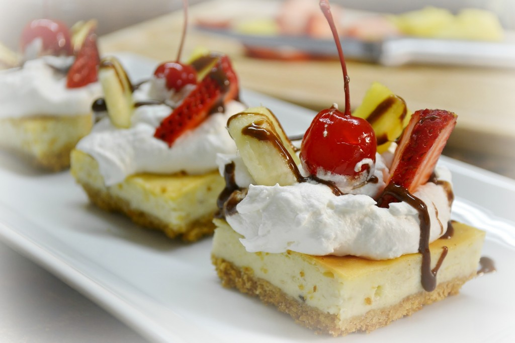 A platter of banana split cheesecake squares prepared with Rada Cutlery products.