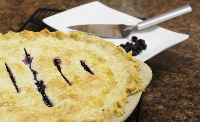 A delicious raspberry pie with a Rada Serrated Pie Server.