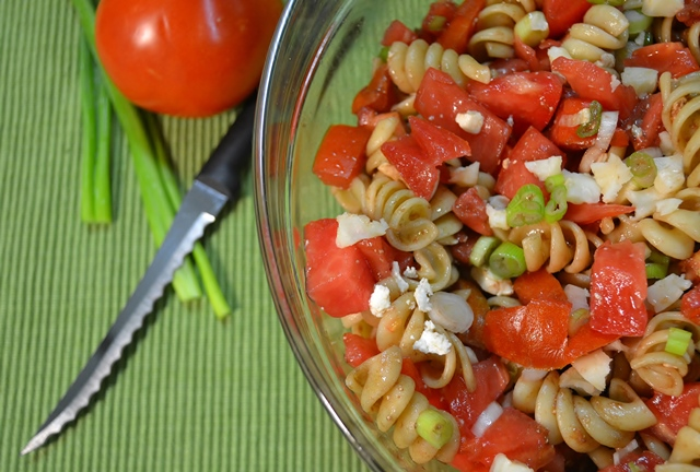 A bowl of pasta salad alongside a Rada Tomato Slicer.