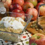 An apple oatmeal breakfast alongside the Rada Food Chopper.