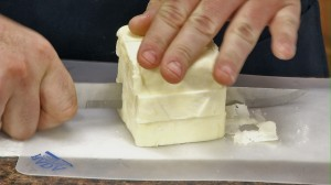 Cut butter up and put into food processor.