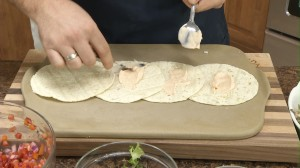 Spread chipotle sauce over tortillas.