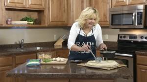 Prepare alfredo sauce and dollop over crust.