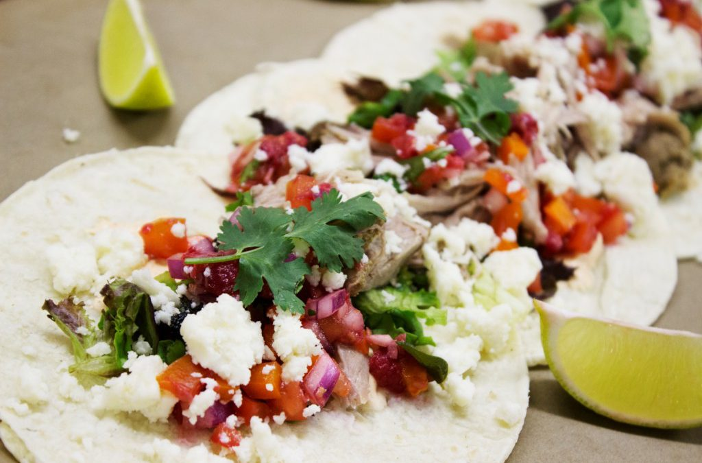 A delicious lineup of carnitas tacos prepared with Rada Cutlery products.