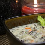 A bowl of chicken and wild rice soup.