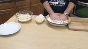 Pat chicken in flour.