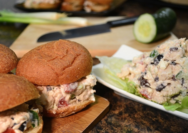A chicken salad sandwich alongside a Rada French Chef knife.