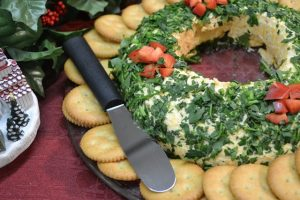 A delicious cheeseball wreath with a Rada Super Spreader.