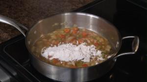 Add flour to mirepoix.