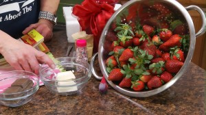 Strawberries in a bowl with sprinkles and chocolate and vanilla almond bark