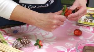 cutting a strawberry with a Rada Granny Paring knife