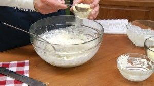 adding romano cheese to the cheese mixture