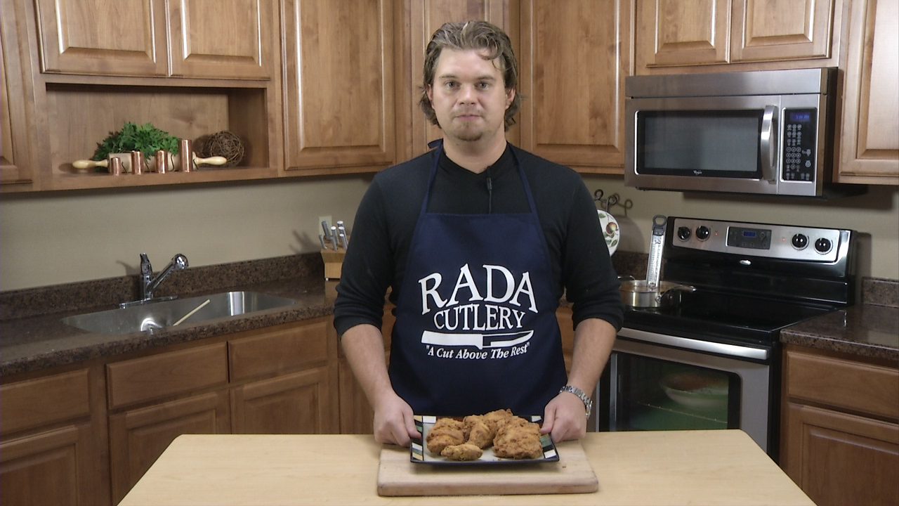 Rada Cutlery's own Chef Blake poses with some homemade fried chicken.