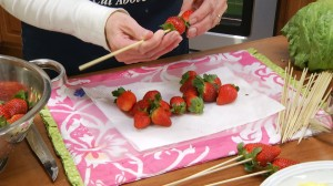 skewering the strawberries