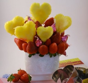 pineapples and strawberries arranged with chocolate into a bouquet