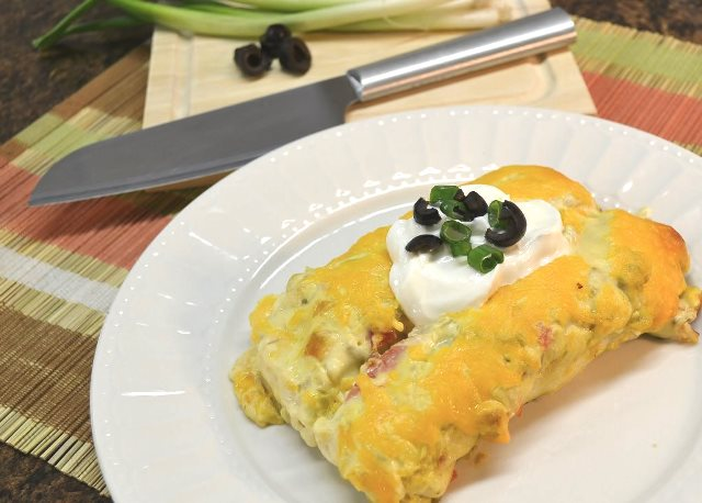 A plate of chicken enchiladas alongside the Rada Cook's Knife.