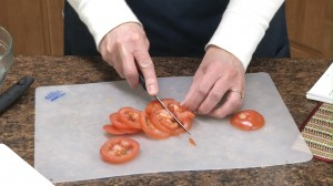 chopping tomatoes to be used in the enchilada sauce